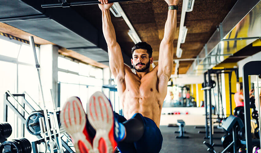 man-working-out-in-gym-and-flexing-abs-LTSNMQP