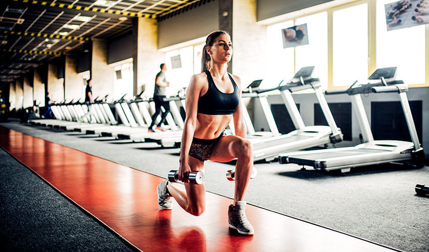 slim-woman-doing-exercise-with-dumbbells-PSH2J3K