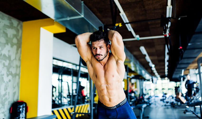 young-man-doing-trx-exercise-in-gym-HVTF6JP